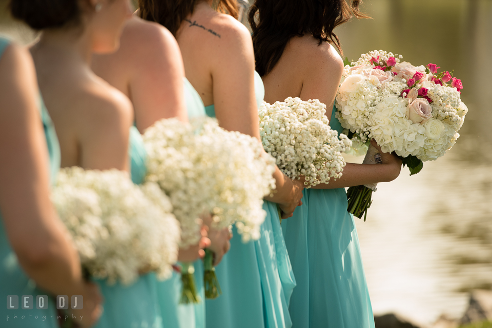 The Oaks Waterfront Inn Bridesmaids and Maid of Honor holding floral bouquets by florist Seasonal Flowers photo by Leo Dj Photography