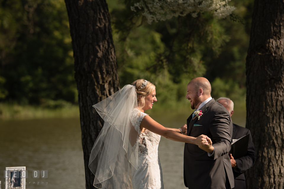 The Oaks Waterfront Inn Bride and Groom in joy after first kiss photo by Leo Dj Photography