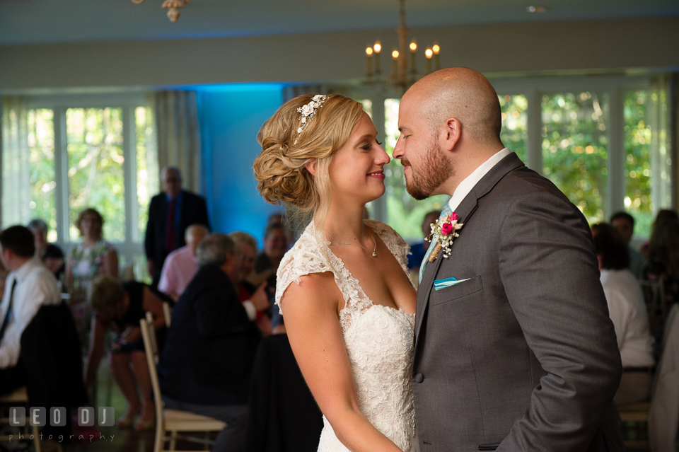 The Oaks Waterfront Inn Bride and Groom smiling together during first dance photo by Leo Dj Photography