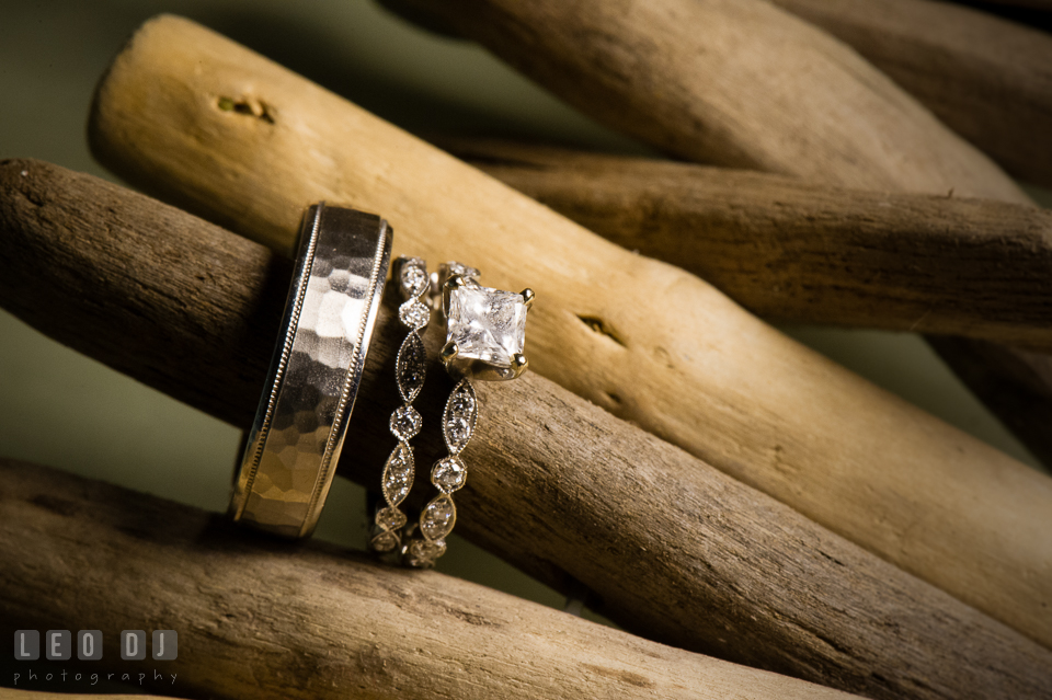 The Oaks Waterfront Inn close up shot of Bride and Groom's engagement ring and wedding bands photo by Leo Dj Photography
