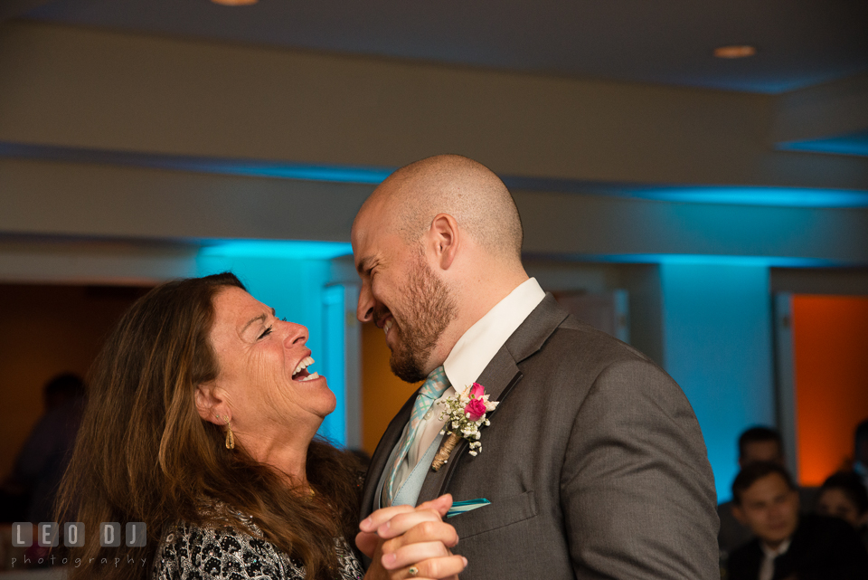 The Oaks Waterfront Inn Mother of Groom laughing while doing parent dance with son photo by Leo Dj Photography