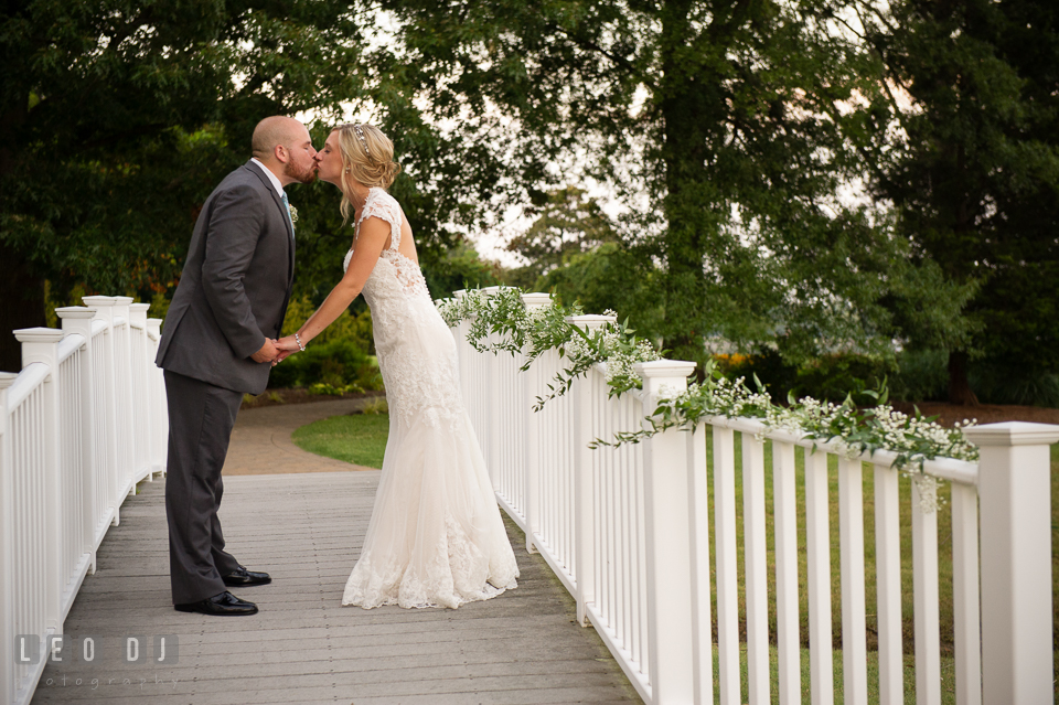 The Oaks Waterfront Inn Bride and Groom kissing on the Bridge photo by Leo Dj Photography