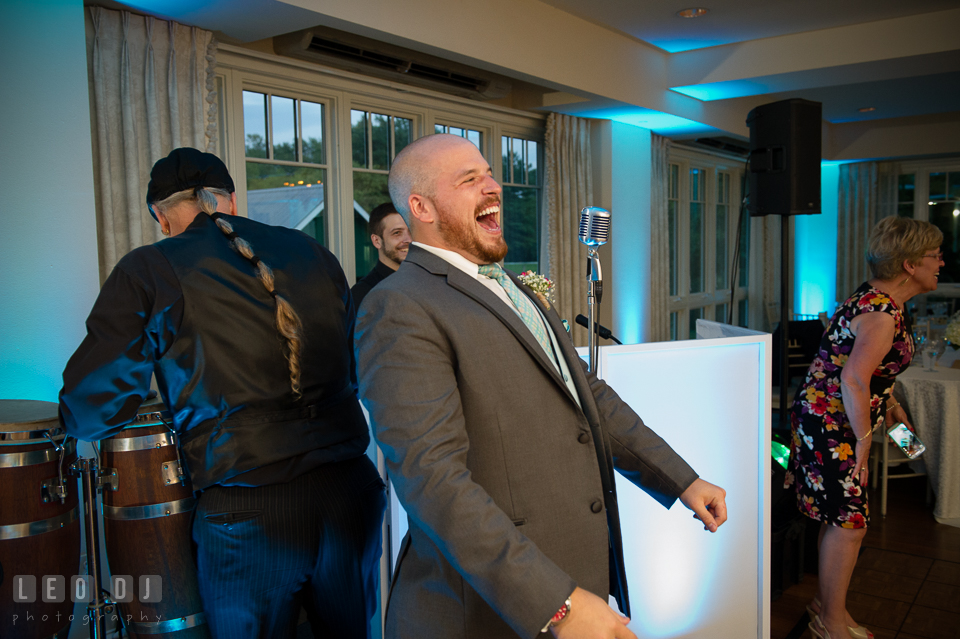 The Oaks Waterfront Inn Groom laughing seeing Darth Vader impersonator entering ballroom photo by Leo Dj Photography