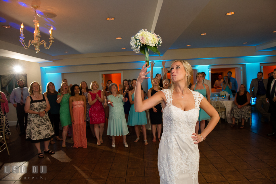 The Oaks Waterfront Inn Bride toss bouquet to the single ladies guests photo by Leo Dj Photography