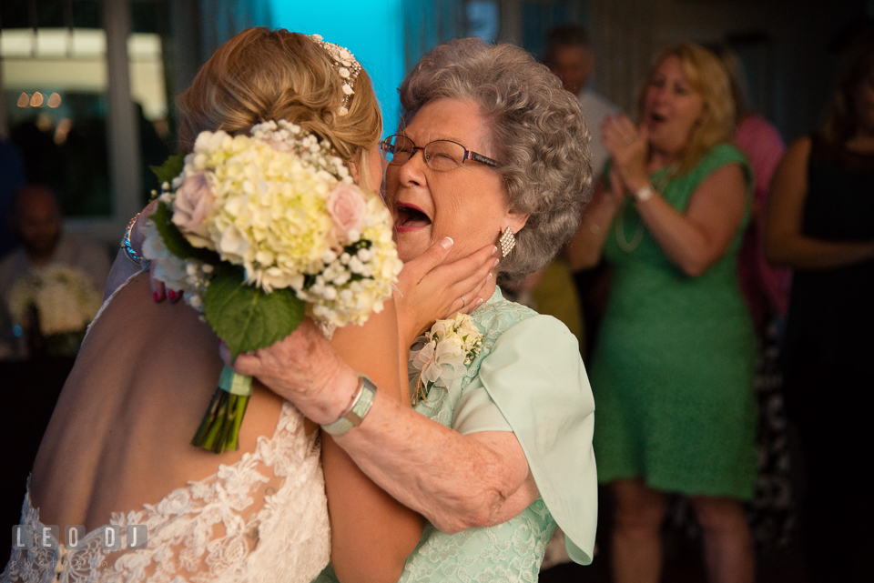 The Oaks Waterfront Inn Bride hugging Grandmother who caught the tossed flower bouquet photo by Leo Dj Photography