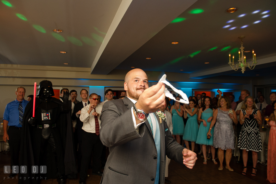 The Oaks Waterfront Inn Groom almost tossing garter to single men and Darth Vader photo by Leo Dj Photography