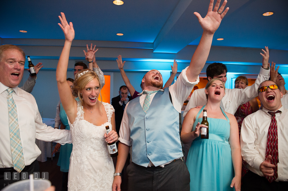 The Oaks Waterfront Inn Bride, Groom, family and guests singing Don't Stop Believin' from Journey photo by Leo Dj Photography