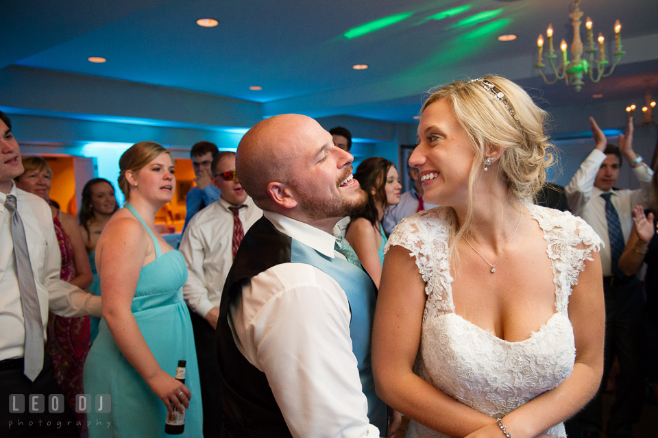 The Oaks Waterfront Inn Bride and Groom singing and dancing together photo by Leo Dj Photography