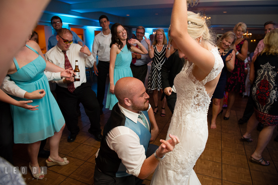 The Oaks Waterfront Inn Groom dancing and kneeling in front of Bride photo by Leo Dj Photography
