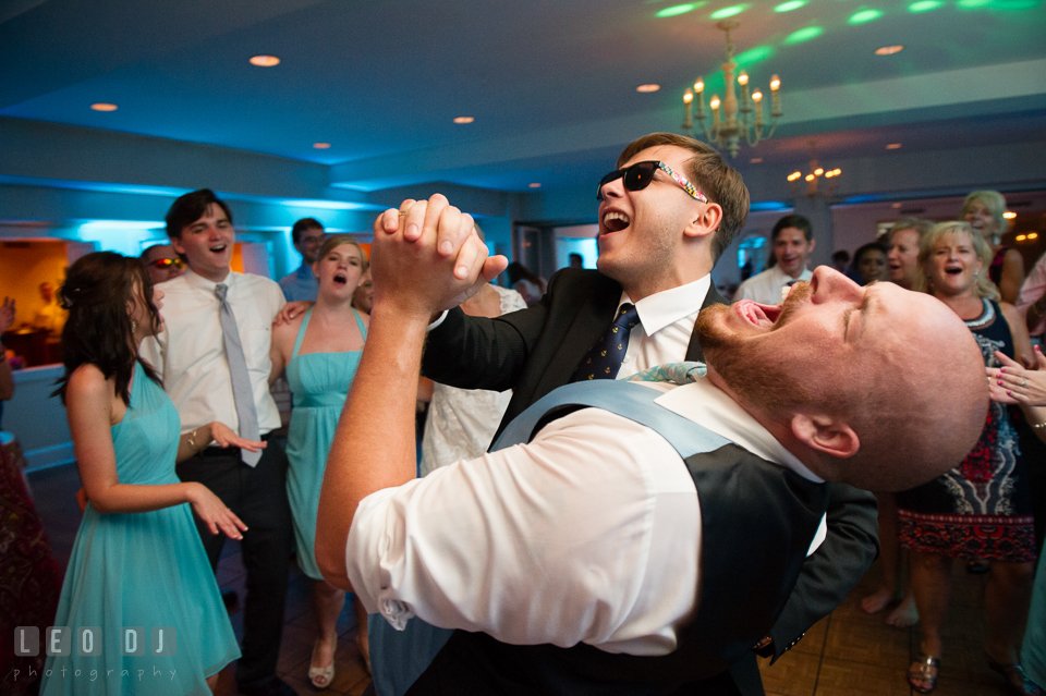 The Oaks Waterfront Inn Groom dancing and signing with another male guest photo by Leo Dj Photography