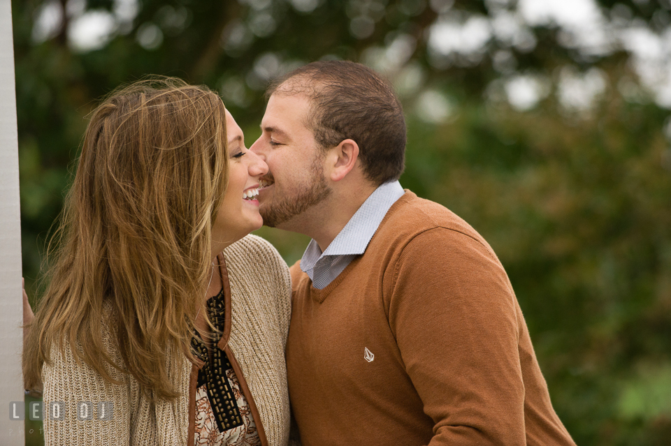 Engaged couple embracing each other and laughing. Eastern Shore Maryland pre-wedding engagement photo session at St Michaels MD, by wedding photographers of Leo Dj Photography. http://leodjphoto.com