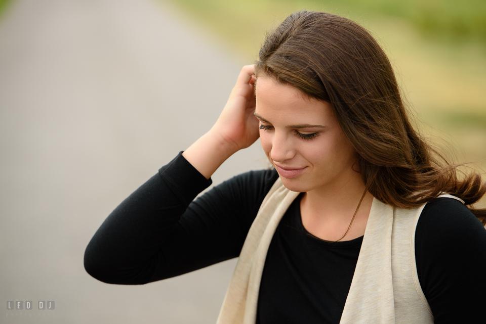 McDonogh High School Maryland senior girl brushing her hair photo by Leo Dj Photography.