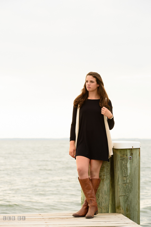 McDonogh High School Maryland senior beautiful girl leaning by a boat dock posts photo by Leo Dj Photography.