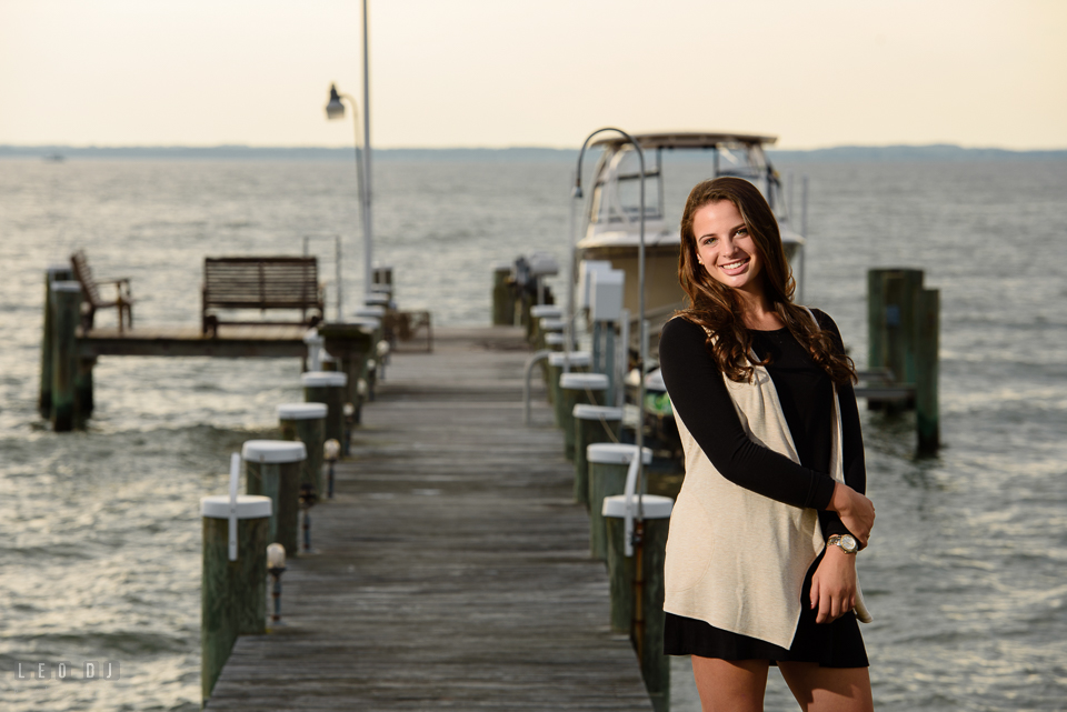 McDonogh High School Maryland senior beautiful girl posing by a boat pier at Chesapeake Bay photo by Leo Dj Photography.