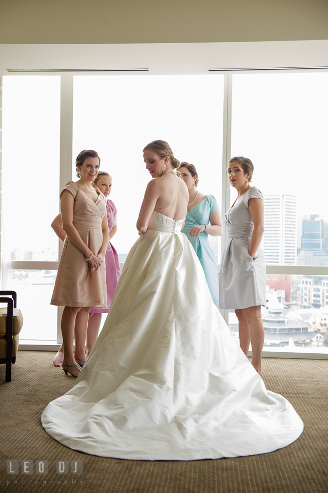 Four Seasons Hotel Baltimore Bride showing wedding gown to Bridesmaids photo by Leo Dj Photography