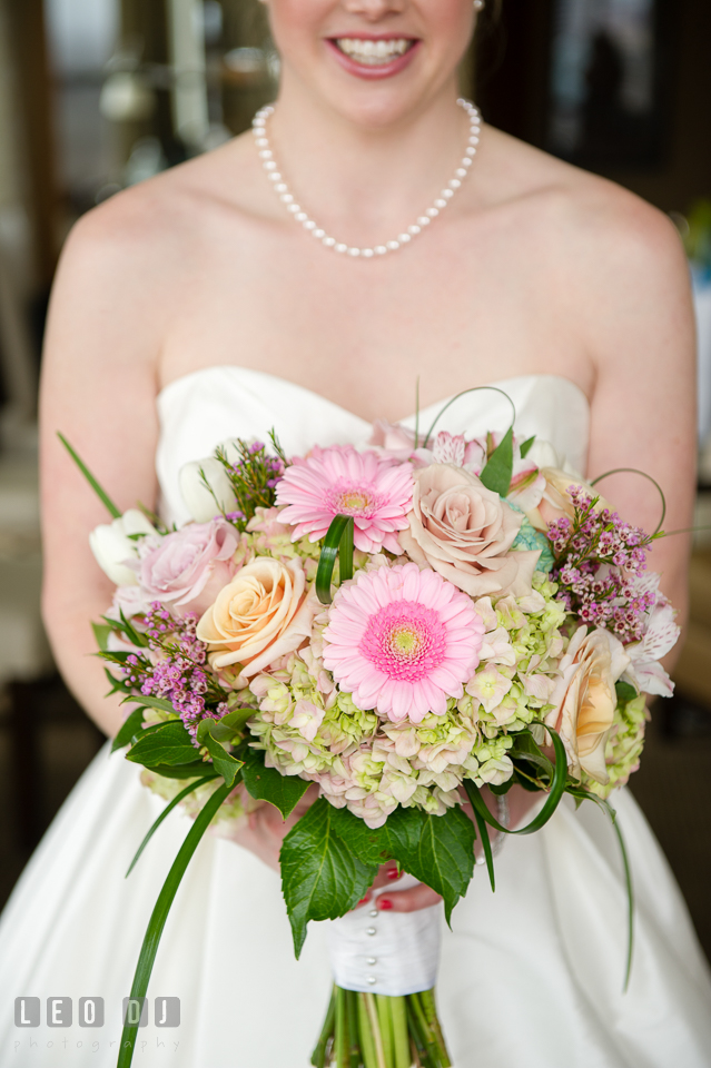 Four Seasons Hotel Baltimore Bride showing wedding bridal bouquet by Petal Pusher Florist photo by Leo Dj Photography