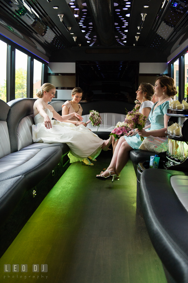 Charm City Baltimore Maryland wedding Bride with Bridesmaids inside limo by American Limousine photo by Leo Dj Photography