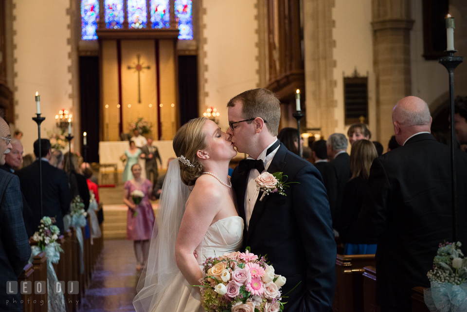 Christ Lutheran Church Inner Harbor Baltimore Maryland Bride Groom kissing at ceremony recessional photo by Leo Dj Photography