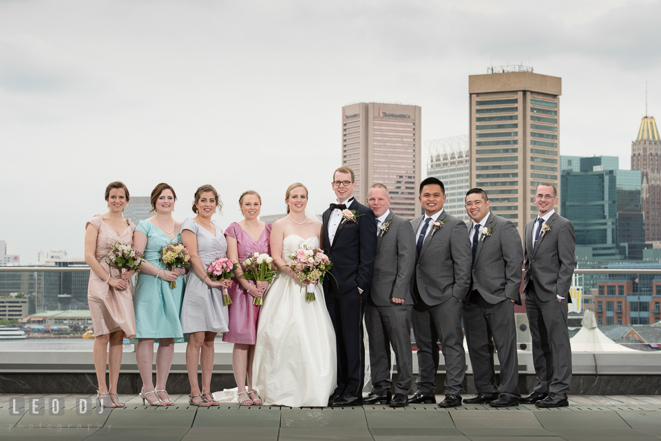 Four Seasons Hotel Baltimore wedding party with downtown Inner Harbor background photo by Leo Dj Photography