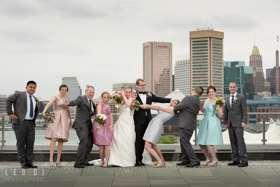 Four Seasons Hotel Baltimore Bride Groom goofing around with wedding party photo by Leo Dj Photography