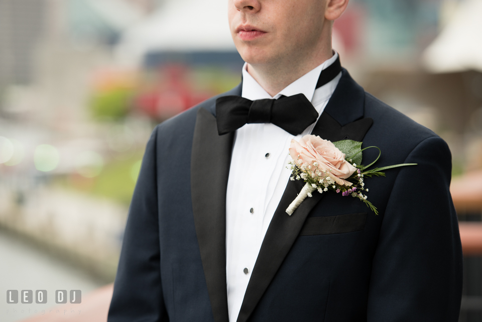 Charm City Baltimore Groom with tuxedo, bow tie, and boutonniere photo by Leo Dj Photography