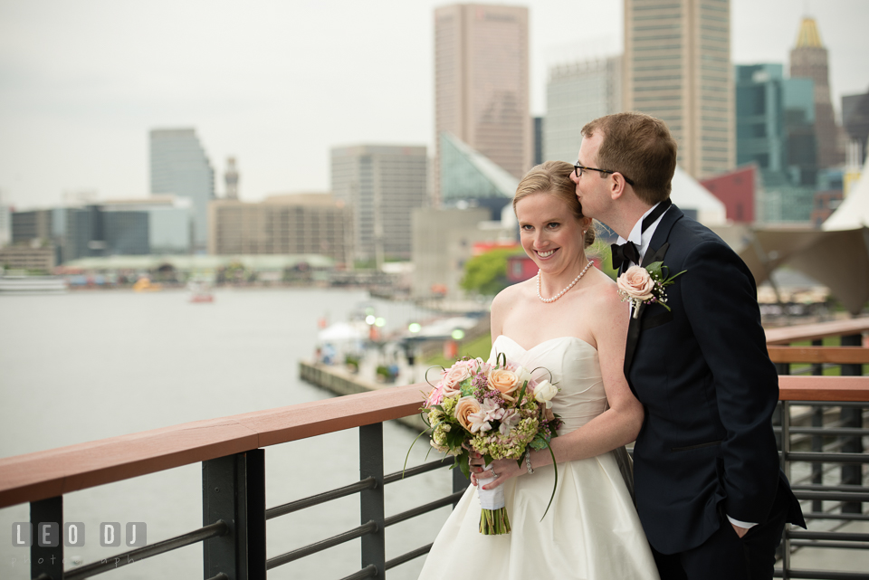 Charm City Baltimore wedding Groom kissing Bride photo by Leo Dj Photography