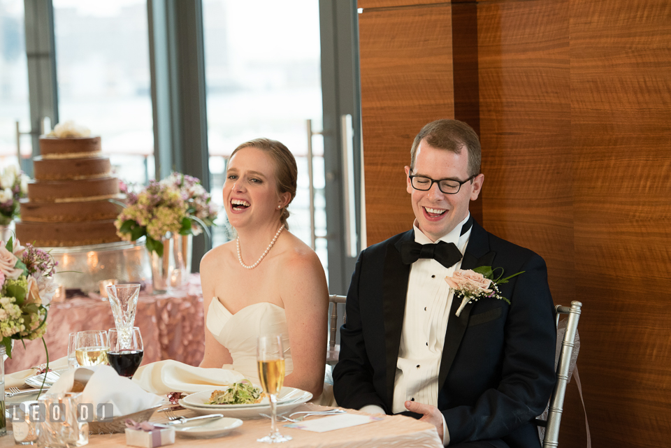 Four Seasons Hotel Baltimore wedding reception Bride and Groom at sweet heart table laughing photo by Leo Dj Photography