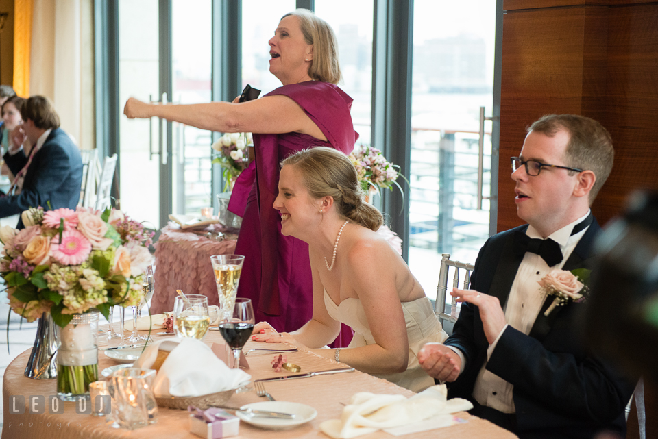 Four Seasons Hotel Baltimore Mother of Bride and wedding couple cheering at reception photo by Leo Dj Photography