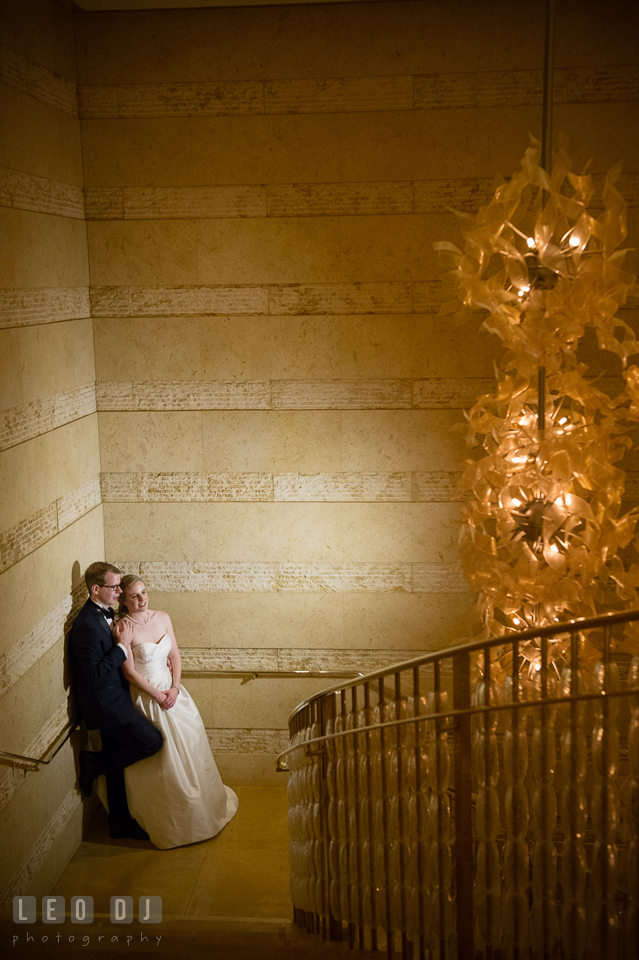 Four Seasons Hotel Baltimore wedding Bride and Groom cuddling on the stairs photo by Leo Dj Photography