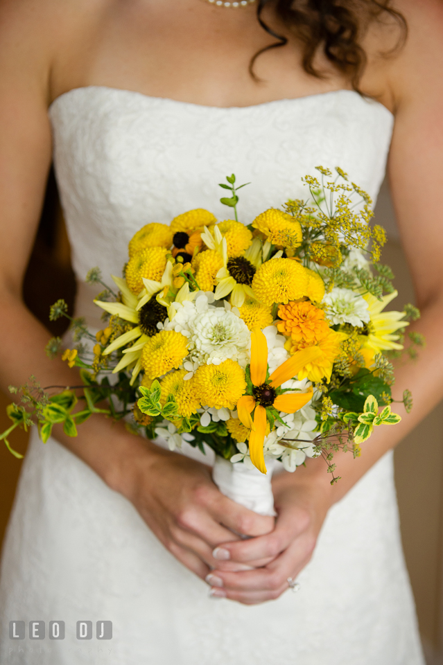 Bride and her floral bridal bouquet florist Willow Oak Flower and Herb Garden. Kent Island Maryland Chesapeake Bay Beach Club wedding photo, by wedding photographers of Leo Dj Photography. http://leodjphoto.com