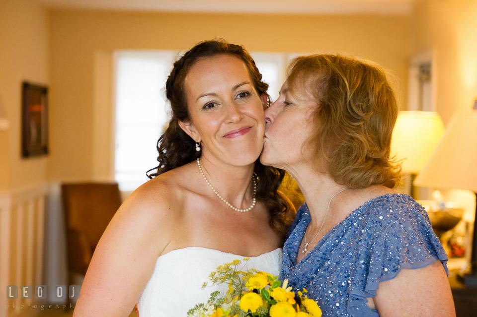 Mother kiss Bride's cheek. Kent Island Maryland Chesapeake Bay Beach Club wedding photo, by wedding photographers of Leo Dj Photography. http://leodjphoto.com