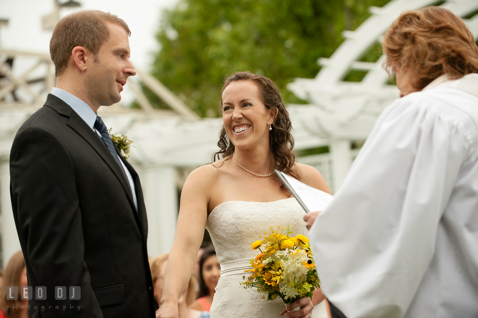 The Bride looking at Groom, smiling during the blessing ceremony. Kent Island Maryland Chesapeake Bay Beach Club wedding photo, by wedding photographers of Leo Dj Photography. http://leodjphoto.com