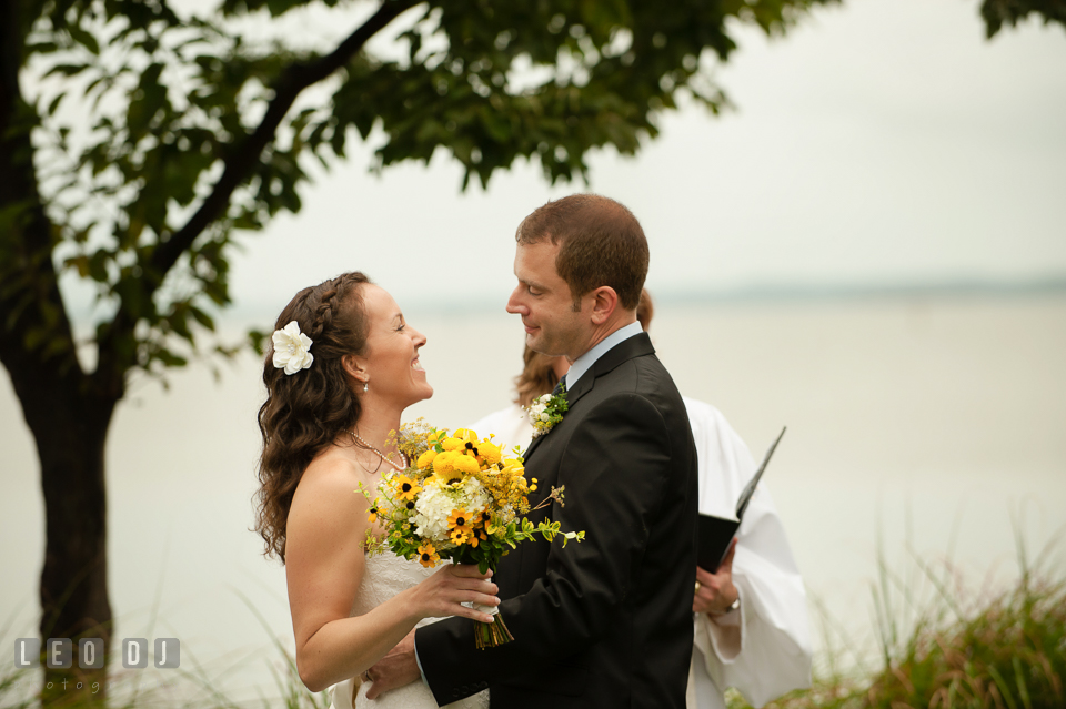 The Bride and Groom during the wedding ceremony about to do their first kiss. Kent Island Maryland Chesapeake Bay Beach Club wedding photo, by wedding photographers of Leo Dj Photography. http://leodjphoto.com