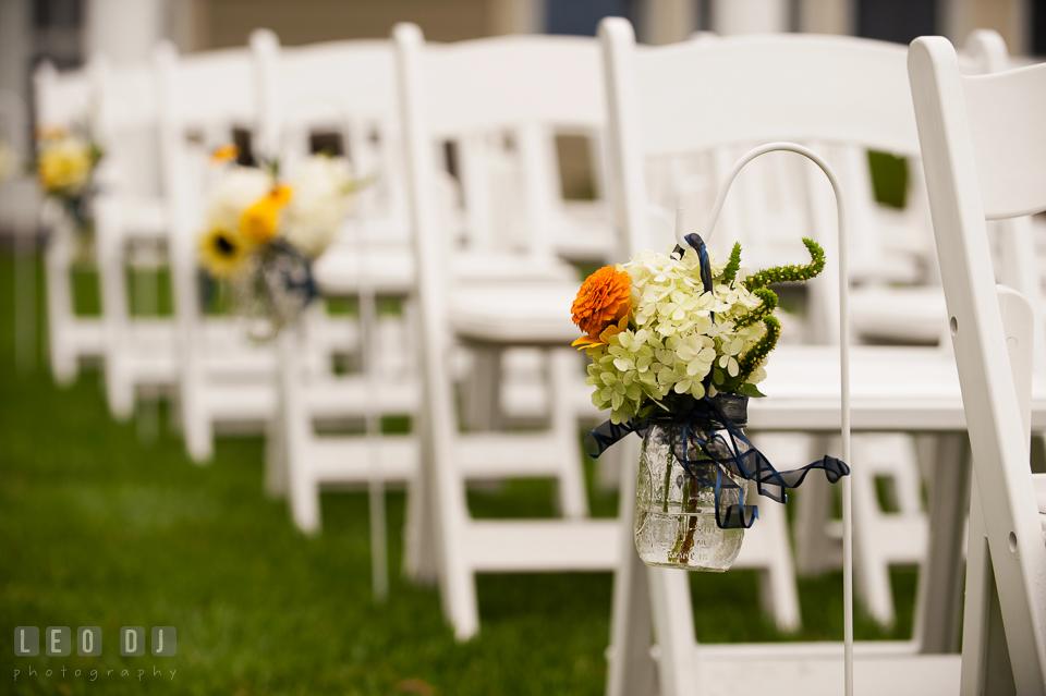 Stunning blooms adorned the aisle by florist Willow Oak Flower and Herb Garden. Kent Island Maryland Chesapeake Bay Beach Club wedding photo, by wedding photographers of Leo Dj Photography. http://leodjphoto.com