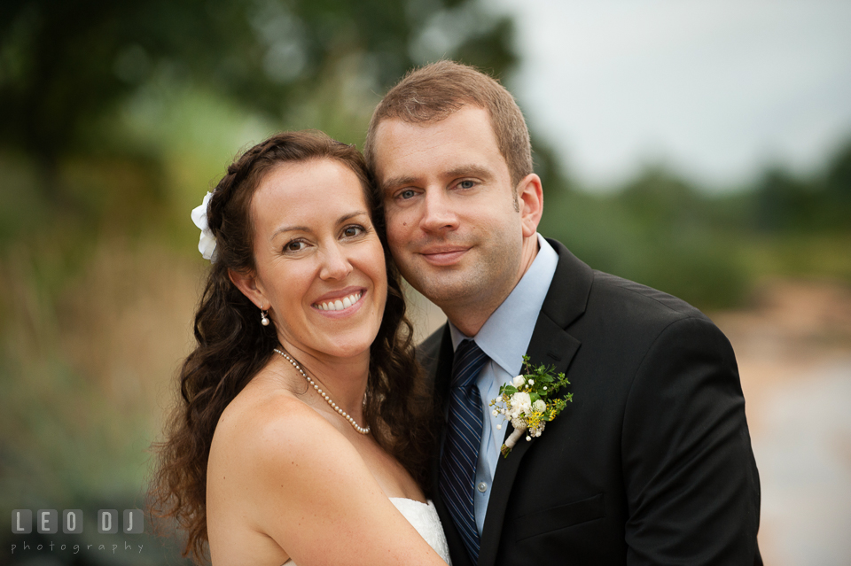 The happy expressions of the Bride and Groom after the wedding ceremony. Kent Island Maryland Chesapeake Bay Beach Club wedding photo, by wedding photographers of Leo Dj Photography. http://leodjphoto.com