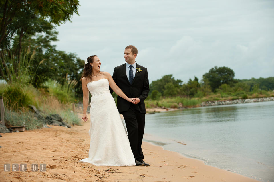 Bride and Groom on the Beach laughing together. Kent Island Maryland Chesapeake Bay Beach Club wedding photo, by wedding photographers of Leo Dj Photography. http://leodjphoto.com