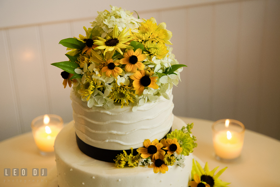 Summer blooms from Willow Oak Flower and Herb Garden serve as enchanting cake topper by Fiona's Cakes. Kent Island Maryland Chesapeake Bay Beach Club wedding photo, by wedding photographers of Leo Dj Photography. http://leodjphoto.com