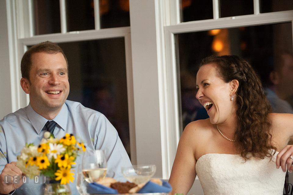 Bride and Groom laughing, enjoying the toast speeches. Kent Island Maryland Chesapeake Bay Beach Club wedding photo, by wedding photographers of Leo Dj Photography. http://leodjphoto.com