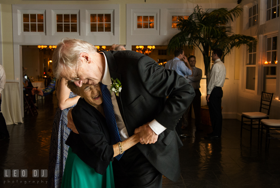 Father of the Groom and grandmother dancing and laughing together. Kent Island Maryland Chesapeake Bay Beach Club wedding photo, by wedding photographers of Leo Dj Photography. http://leodjphoto.com