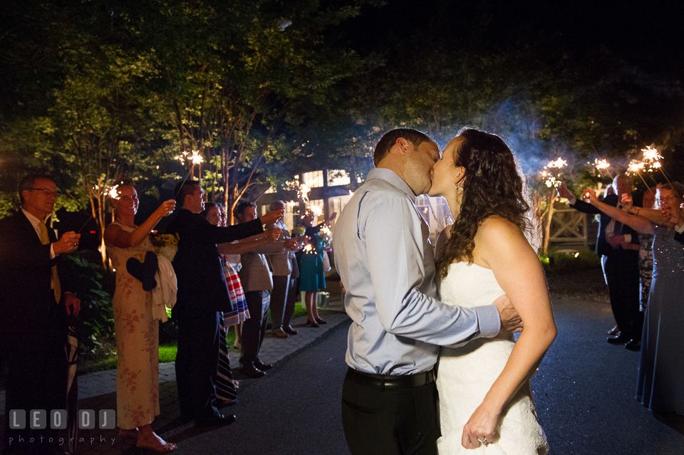 Sparklers and lined up guests to send off Bride and Groom in a grand exit. Kent Island Maryland Chesapeake Bay Beach Club wedding photo, by wedding photographers of Leo Dj Photography. http://leodjphoto.com
