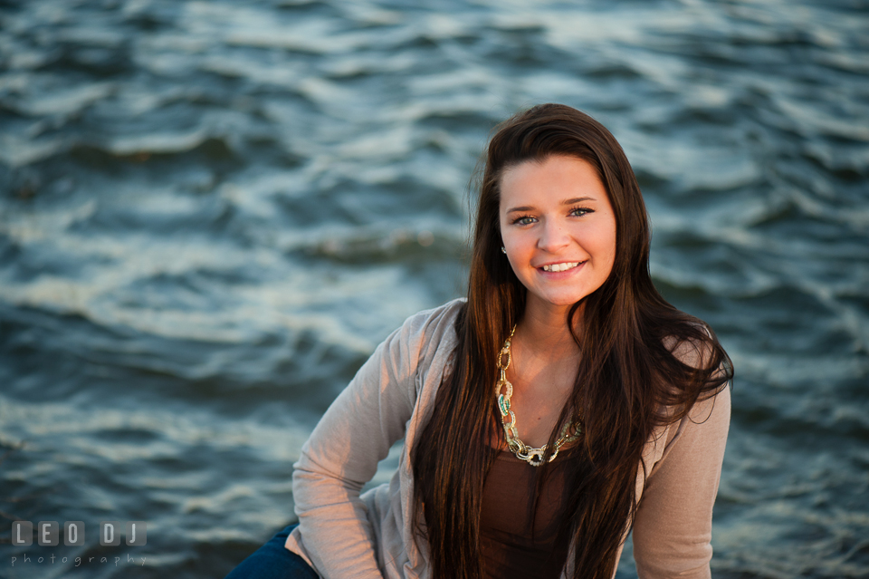 Sweet brunette girl posing and smiling by the water. Eastern Shore, Maryland, Queen Anne's County High School senior portrait session by photographer Leo Dj Photography. http://leodjphoto.com