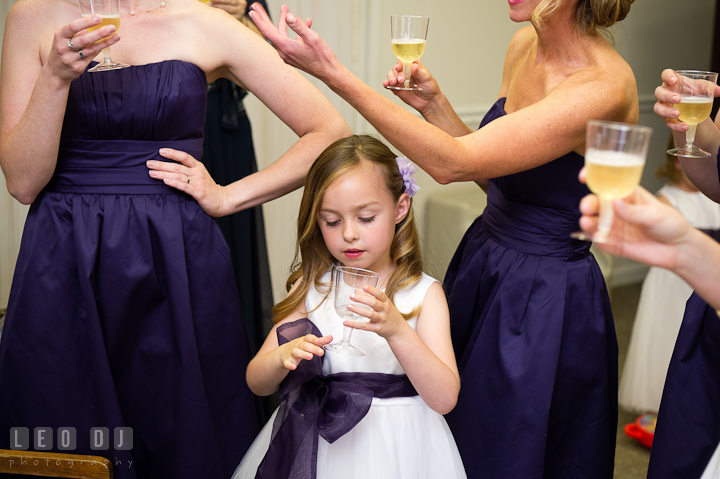 The ladies having a toast for the Bride before the ceremony. St Andrews United Methodist wedding photos at Annapolis, Eastern Shore, Maryland by photographers of Leo Dj Photography.