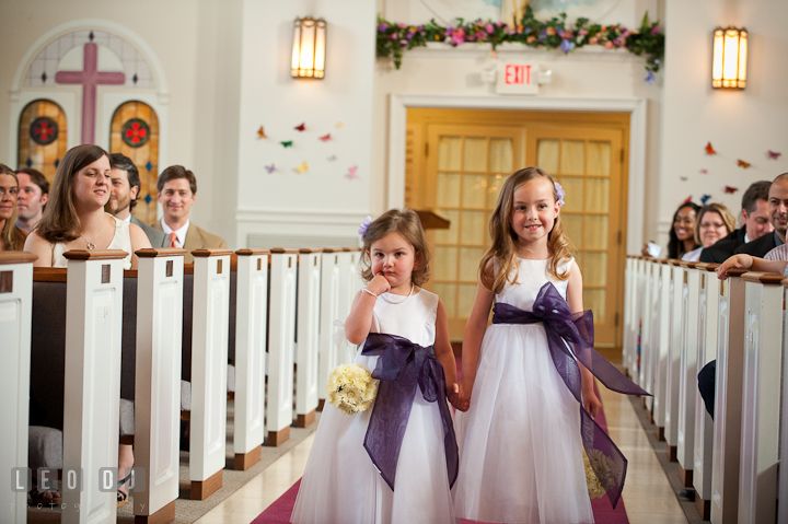 Flower girls walking down the isle. St Andrews United Methodist wedding photos at Annapolis, Eastern Shore, Maryland by photographers of Leo Dj Photography.