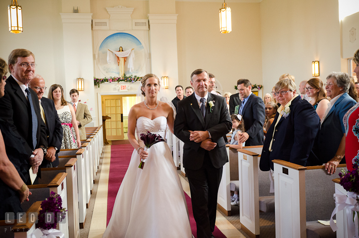 Bride escorted by Father of the Bride walking down the isle for the procession ceremony. St Andrews United Methodist wedding photos at Annapolis, Eastern Shore, Maryland by photographers of Leo Dj Photography.