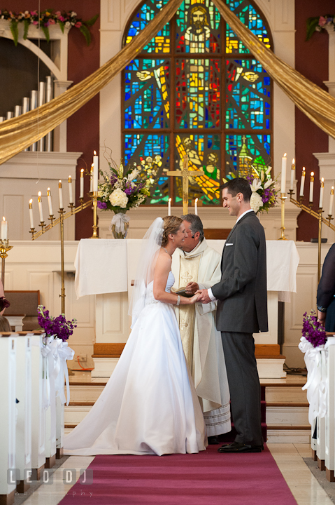 Bride and Groom holding hands and smiled together at the ceremony. St Andrews United Methodist wedding photos at Annapolis, Eastern Shore, Maryland by photographers of Leo Dj Photography.