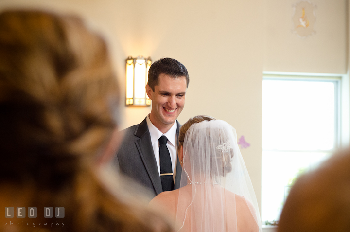 Groom smiled and recited his vows to the Bride. St Andrews United Methodist wedding photos at Annapolis, Eastern Shore, Maryland by photographers of Leo Dj Photography.