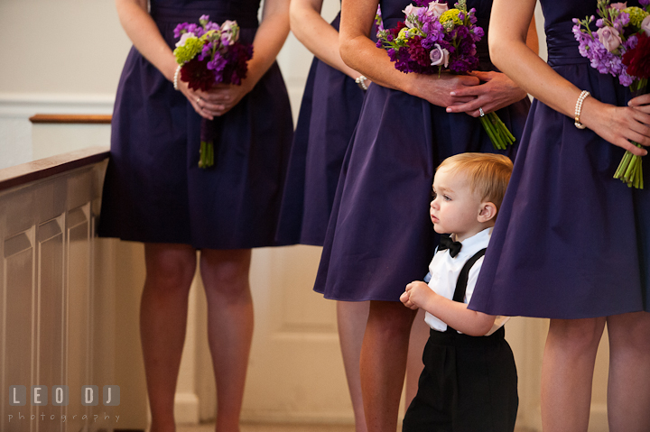 Ring bearer boy amidst the Bridesmaids purple dress. St Andrews United Methodist wedding photos at Annapolis, Eastern Shore, Maryland by photographers of Leo Dj Photography.