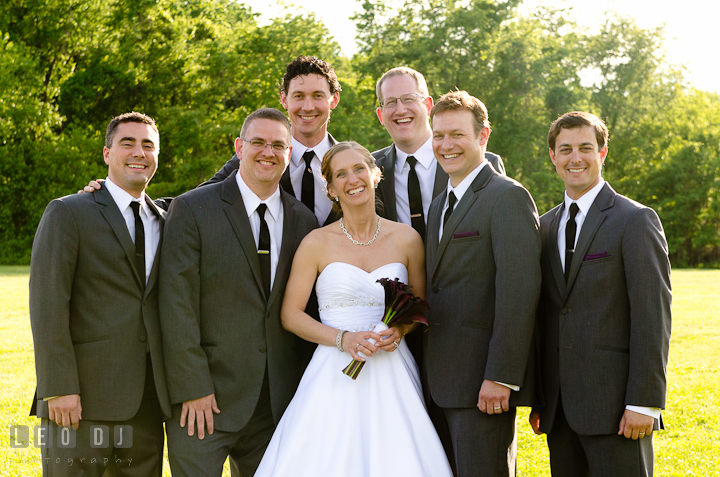 Bride photo group shot with Best Man and Groomsmen. St Andrews United Methodist wedding photos at Annapolis, Eastern Shore, Maryland by photographers of Leo Dj Photography.