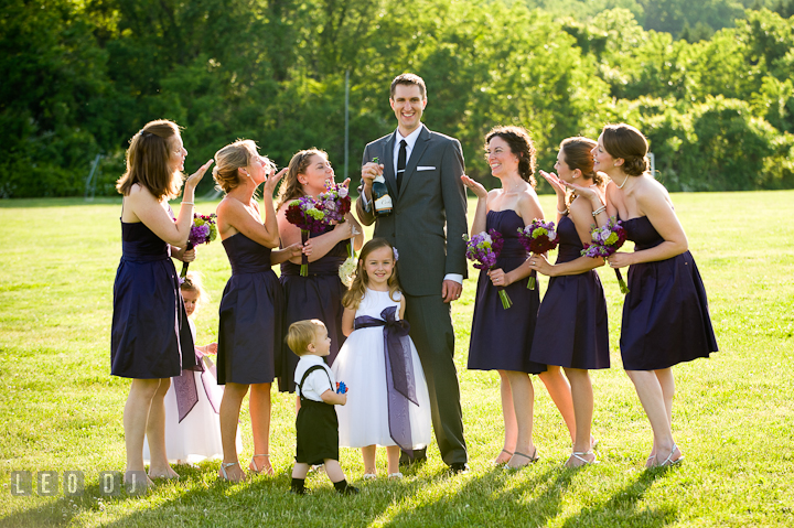 Groom photo group shot with Matron of Honor and Bridesmaids. St Andrews United Methodist wedding photos at Annapolis, Eastern Shore, Maryland by photographers of Leo Dj Photography.