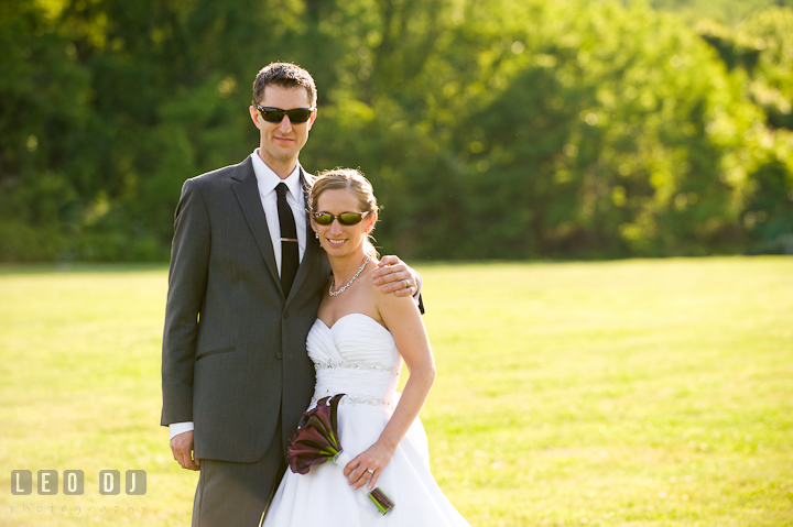 Bride and Groom wearing sunglasses. St Andrews United Methodist wedding photos at Annapolis, Eastern Shore, Maryland by photographers of Leo Dj Photography.